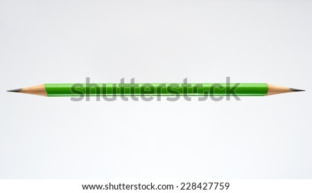 Pencil that is Sharpened on Both Sides isolated on White Background with Text Space - stock photo