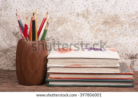 Pencil Vase, hardback books on wooden table. Back to school. Copy space - stock photo