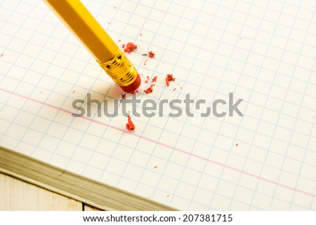 pencil with eraser on exercise book  background - stock photo