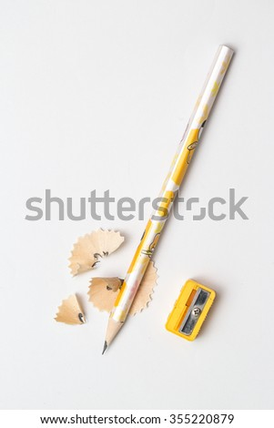 Pencil with sharpening shavings  - stock photo