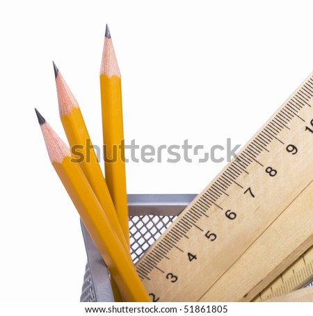 pencils and wooden rulers in a support on a white background - stock photo