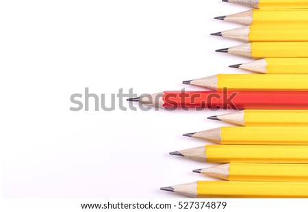 Pencils arranged horizontally in a jagged line with one standing out from the rest, with space for text