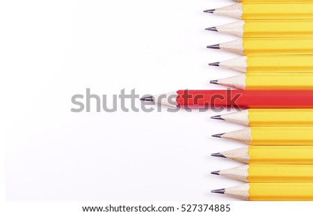 Pencils arranged horizontally in a line with one standing out from the rest, with space for text