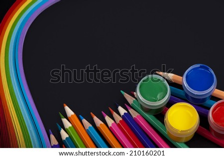 pencils color paper for a kviling  on a black background - stock photo