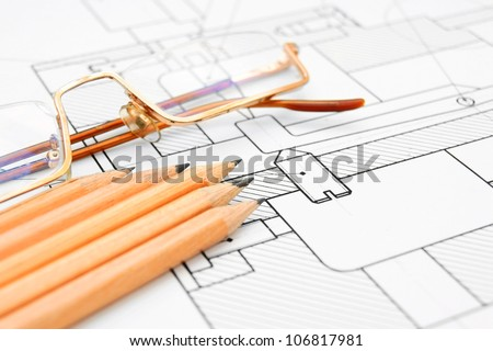 Pencils, glasses on the drawing . - stock photo
