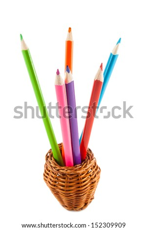 Pencils in a glass on a white background.