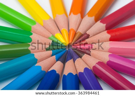 Pencils in arrange in color wheel  on white background