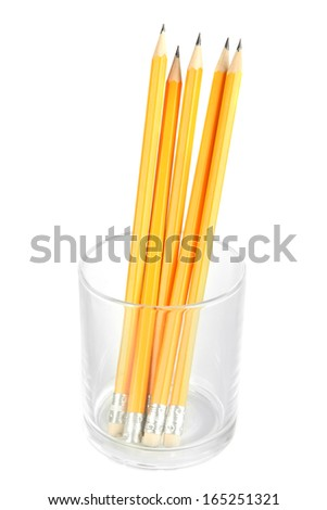 Pencils in glass isolated on white - stock photo