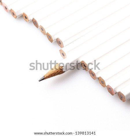 Pencils in line which one point in different direction