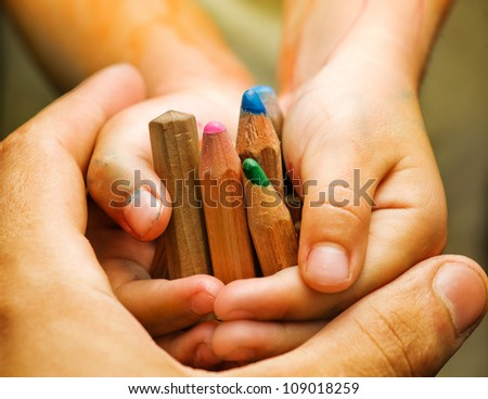 Pencils in the children's hands. - stock photo