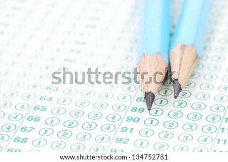Pencils on blank test sheet close up - stock photo