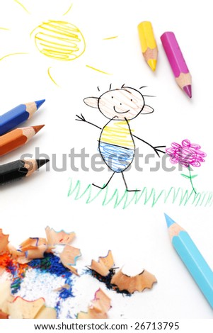 Pencils on paper with child's drawing - stock photo
