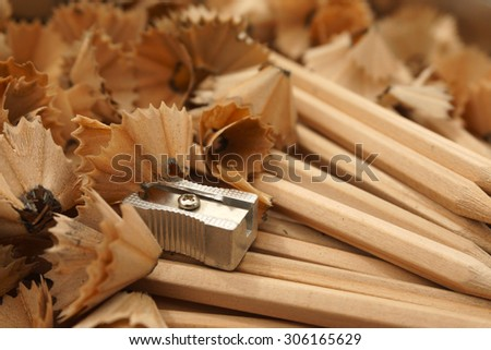 Pencils, sharpener and wood shavings - close up, macro