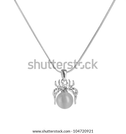 Pendant in form of spider with pearl isolated on white - stock photo