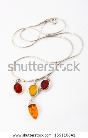 Pendant on silver chain isolated on the white  - stock photo