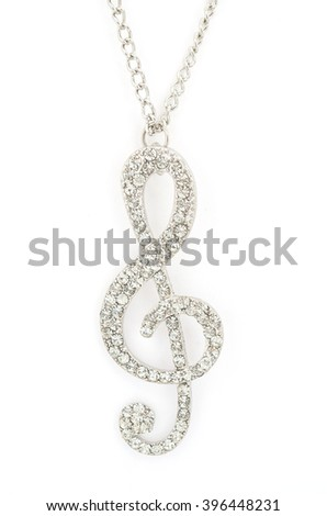 Pendant with a treble clef isolated on white - stock photo