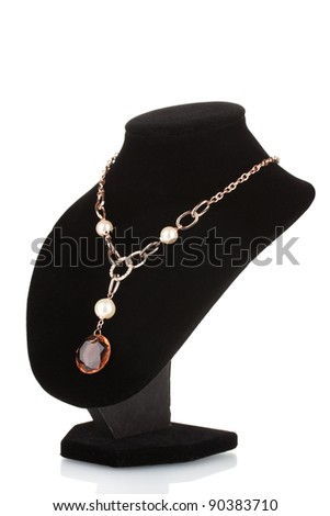 Pendant with an orange gem on mannequin isolated on white - stock photo