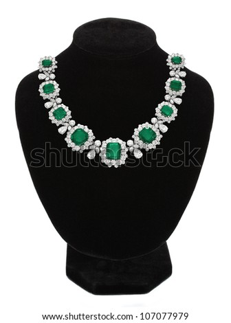 Pendant with green gem stones on black mannequin isolated on white - stock photo