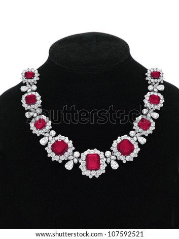 Pendant with red gem stones on black mannequin isolated on white - stock photo