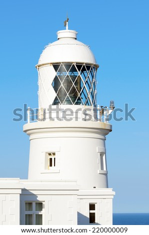 Pendeen Lighthouse in early morning sun near St Agnes in Cornwall England - stock photo