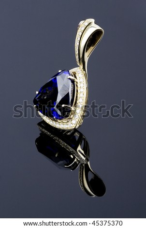 pendent with big blue gem and diamonds