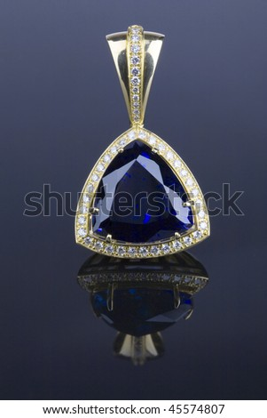 pendent with big blue gem and diamonds - stock photo