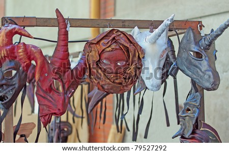 Pending artisanal masks of different kind and types - stock photo