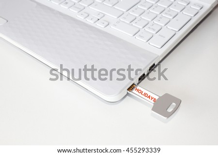 Pendrive in a laptop with the holidays word