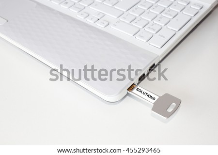 Pendrive in a laptop with the solutions word
