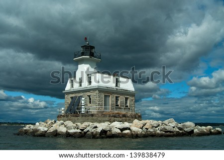 Penfield Reef Lighthouse is considered haunted by Keeper Jorden who drowned when his boat capsized near the light. His ghost has recorded helping mariners in stormy weather. - stock photo