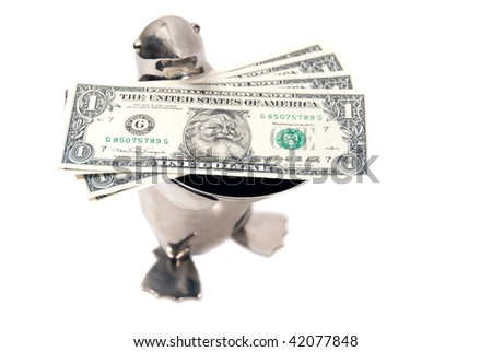 penguin bearing gifts of limited edition legal tender us dollar notes with santa's picture - stock photo