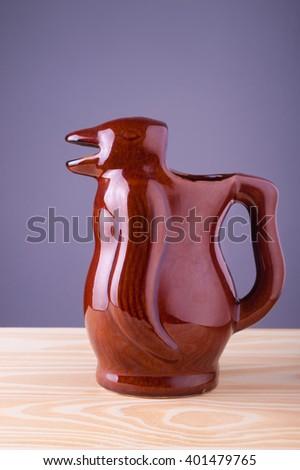 Penguin wine jar, copy space. - stock photo