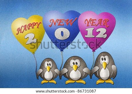 Penguins happy new year 2012 recycled paper craft on paper background - stock photo