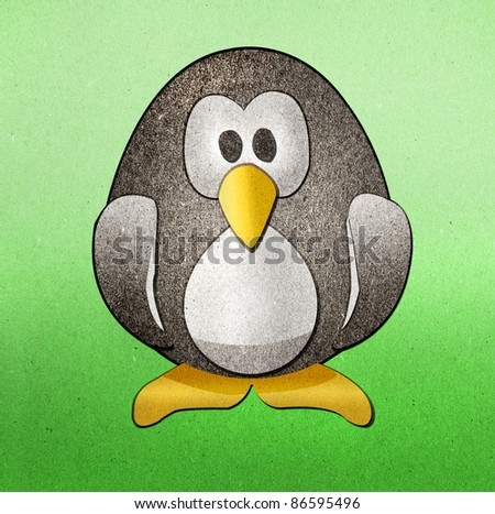 Penguins recycled paper craft on paper background - stock photo