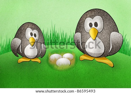 Penguins with  eggs recycled paper craft on paper background - stock photo