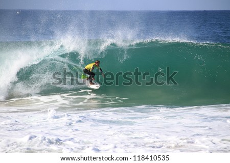 PENICHE, PORTUGAL - OCT 13: Damien Hobgood tube riding a wave in round 1, heat 5 at WCT contest, Rip Curl Pro in Peniche, Portugal on October 13, 2012 - stock photo