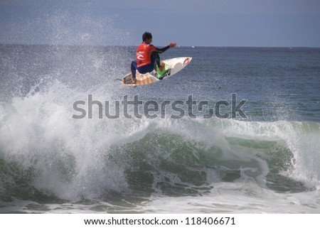 PENICHE, PORTUGAL - OCT 13: Gabriel Medina frontside air in round 1, heat 9 at WCT contest, Rip Curl Pro in Peniche, Portugal on October 13, 2012 - stock photo
