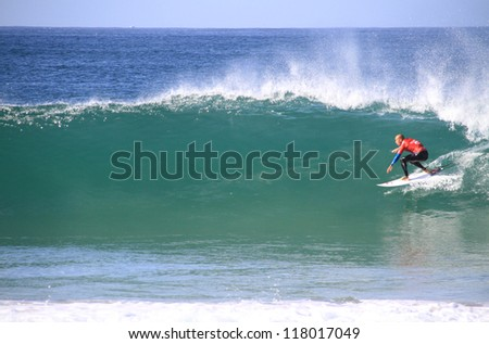 PENICHE, PORTUGAL -  OCT 13: Kelly Slater rides a wave in round 1, heat 5 at WCT contest, Rip Curl Pro in Peniche, Portugal on October 13, 2012 - stock photo