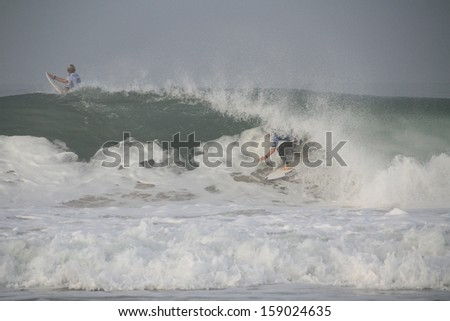 PENICHE, PORTUGAL - OCT 17, 2013: Mick Fanning tube riding a wave in round 4, heat 2 at WCT contest, Moche Rip Curl Pro Peniche, Portugal 17 October 2013  - stock photo