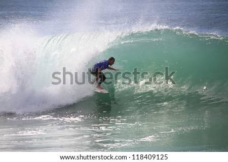 PENICHE, PORTUGAL - OCT 13: Travis Logie tube riding a wave in round 1, heat 11 at WCT contest, Rip Curl Pro in Peniche, Portugal on October 13, 2012 - stock photo