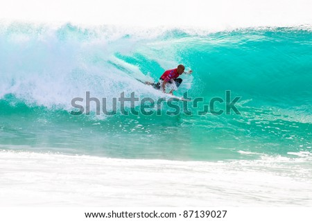 PENICHE, PORTUGAL - OCTOBER 16 : Kelly Slater (USA) competes in the first round of the 2011 Rip Curl Pro on October 16, 2011 in Peniche, Portugal - stock photo