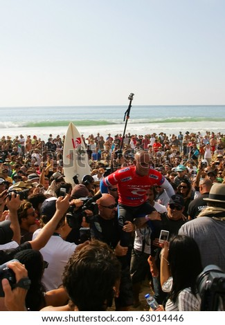PENICHE, PORTUGAL - OCTOBER 14 : Kelly Slater (USA) winner of Rip Curl Pro 2010 Final  October 14, 2010 in Peniche, Portugal - stock photo