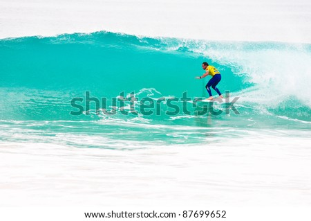 PENICHE, PORTUGAL - OCTOBER 16 : Taylor Knox (USA) competes in the first round of the 2011 Rip Curl Pro on October 16, 2011 in Peniche, Portugal - stock photo