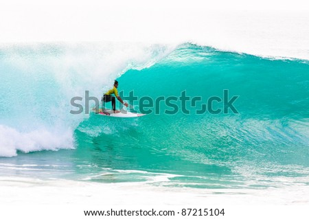 PENICHE, PORTUGAL - OCTOBER 16 : Travis Logie (ZAF) competes in the first round of the 2011 Rip Curl Pro on October 16, 2011 in Peniche, Portugal - stock photo