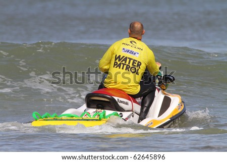 PENICHE, PORTUGAL - OCTOBER 9: Unidentified water patrol officer patrols the waters by The 3rd Rip Curl Women's Pro Portugal, October 9, 2010 in Peniche, Portugal - stock photo