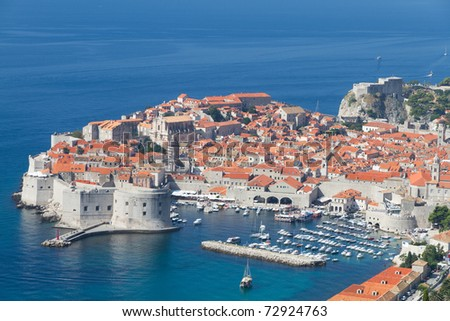 peninsula of walled Dubrovnik old town with harbor, Croatia