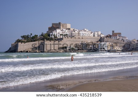 PENISCOLA, SPAIN - SEPTEMBER 25, 2014: View of the beach and the walled city of Peniscola