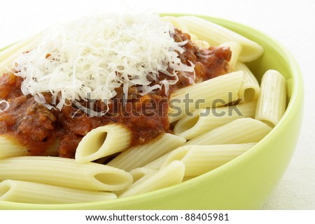 Penne  bolognese delicious classic pasta recipe, with fresh chunky and delicious pasta sauce with beef, pork, lots of vegetables and tons of flavor. - stock photo
