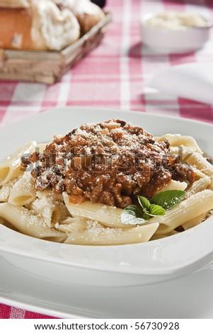 Penne Bolognese. Food photography. Italian cuisine accompanied by bolognese sauce. - stock photo