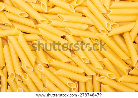 Penne italian pasta background, close up - stock photo